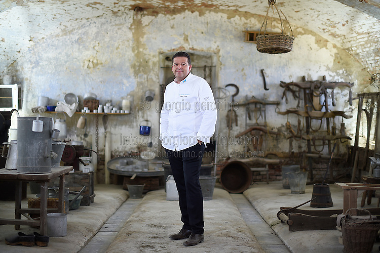 Jacques Chretien, Executive Chef of Sugar Beach at Viceroy Resort in St. Lucia (Caribe), poses for a portrait in the Cascina Colombara during the annual meeting of the Club des Chefs des Chefs in Livorno Ferraris, Vercelli, Italy, July 18, 2015.<br /> The Club des Chefs des Chefs, which is seen as the world's most exclusive gastronomic society, has extremely strict membership criteria: to be accepted into this highly elite club, you need to be the current personal chef of a head of state. If he or she does not have a personal chef, members can be the executive chef of the venue that hosts official State receptions. One of the society's primary purposes is to promote major culinary traditions and to protect the origins of each national cuisine. The Club des Chefs des Chefs also aims to develop friendship and cooperation between its members, who have similar responsibilities in their respective countries. <br /> The annual meeting of the Club has been hosted this year in the production site of the Italian rice company called Riso Acquerello. <br /> © Giorgio Perottino