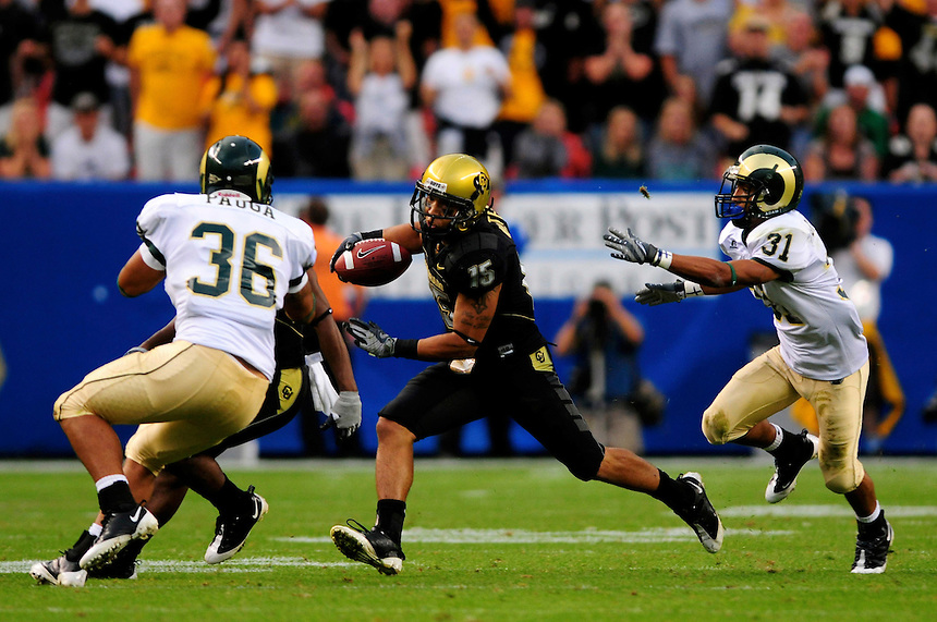 31 Aug 2008: Colorado free safety Ryan Walters (15) returns an interception against Colorado State. Trying to tackle Walters for CSU are tight end Zac Pauga (36) and wide receiver Dion Morton (31). The Colorado Buffaloes defeated the Colorado State Rams 38-17 at Invesco Field at Mile High in Denver, Colorado. FOR EDITORIAL USE ONLY