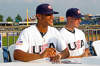 Branden Kline #16 (Virginia) and Tom Murphy #8 (Buffalo) of the USA Baseball Collegiate National Team sign autographs for fans following their game against the Japan Collegiate National Team at the Durham Bulls Athletic Park on July 3, 2011 in Durham, North Carolina.  USA defeated Japan 7-6.  (Brian Westerholt / Four Seam Images)