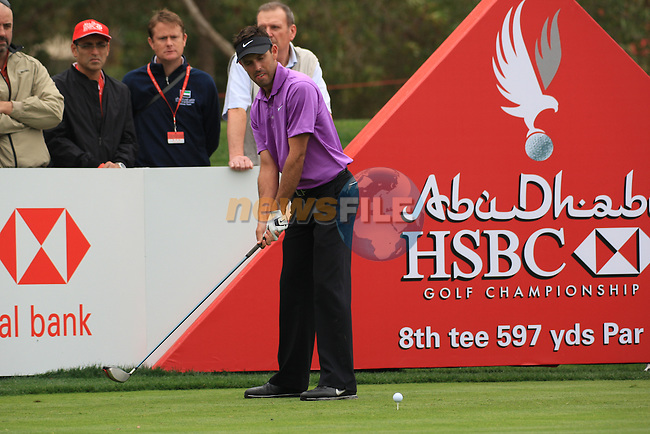 Charl Schwartzel tees up his ball on the 8th on day two of the Abu Dhabi HSBC Golf Championship 2011, at the Abu Dhabi golf club, UAE. 21/1/11..Picture Fran Caffrey/www.golffile.ie.