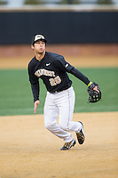 Wake Forest Demon Deacons third baseman Justin Yurchak (20) on defense against the Appalachian State Mountaineers at Wake Forest Baseball Park on February 13, 2015 in Winston-Salem, North Carolina.  The Mountaineers defeated the Demon Deacons 10-1.  (Brian Westerholt/Four Seam Images)