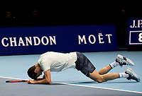 Grigor Dimitrov (BUL) falls to the floor in celebrates a winning match point in the final against David Goffin (BEL). Dimitrov beat David Goffin (BEL) 2 sets to 3.  Nitto ATP Finals Tennis Championships, O2 Arena London, England,19th November 2017.
