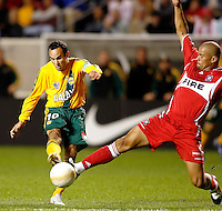 Chicago Fire defender C.J. Brown (2) lunges to block a shot by LA Galaxy forward Landon Donovan (10).  The Chicago Fire defeated the LA Galaxy 3-1 in the championship of the U.S. Open Cup at Toyota Park in Bridgeview, IL on September 27, 2006.