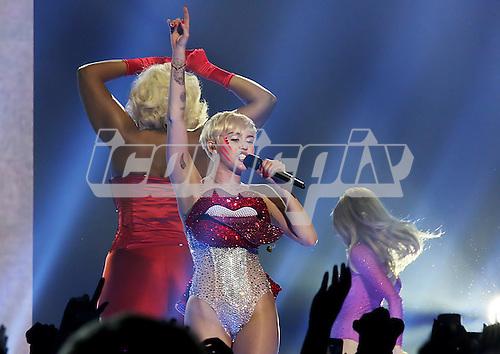 Miley Cyrus - Performing live at Phones4U Arena in Manchester UK - 14 May 2014.  Photo credit: Sakura Henderson/IconicPix