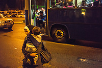 Refugees board buses that will finally take them to Austria after days of being stranded at Budapest's Keleti Railway Terminus when the Hungarian governemnt cancelled trains bound for Austria and Germany. The Hungarian government chartered dozens of buses to take the refugees away in the middle of the night. It took under 3 hours to empty the station of almost all its refugees.