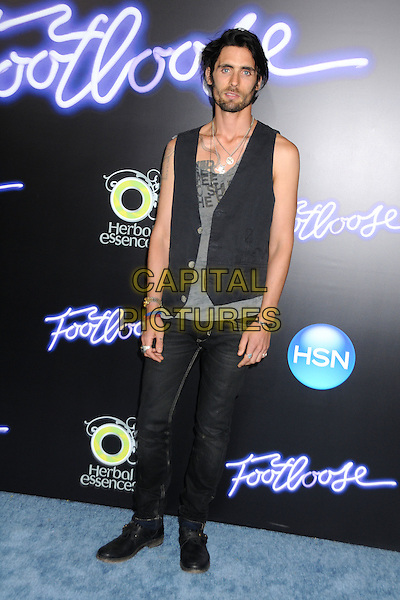 "Tyson Ritter of The All-American Rejects.""Footloose"" Los Angeles Premiere held at the Regency Village Theatre, Westwood, California, USA..October 3rd, 2011.full length top waistcoat jeans denim black stubble facial hair tattoos necklace grey gray .CAP/ADM/BP.©Byron Purvis/AdMedia/Capital Pictures."