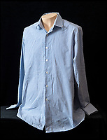 BNPS.co.uk (01202 558833)<br /> Pic:    HAldridge/BNPS<br /> <br /> Ronnie Kray's  pin-striped shirt complete with an 'HM Prison Service' label on the inside colla - sold for £400.<br /> <br /> A chilling bayonet that was used by gangster Ronnie Kray on his victims has sold at auction for over £3,000.<br /> <br /> The 16ins lethal blade was from a First World War rifle but belonged to Ronnie during his and twin Reggie's reign of terror in London's East End in the 1960s.<br /> <br /> Alongside the weapon, several personal items relating to the convicted murderer's time in prison were also sold.<br /> <br /> These included his prison-issue towel which has his surname and prisoner number written on along with the menacing words 'Do Not Remove'.