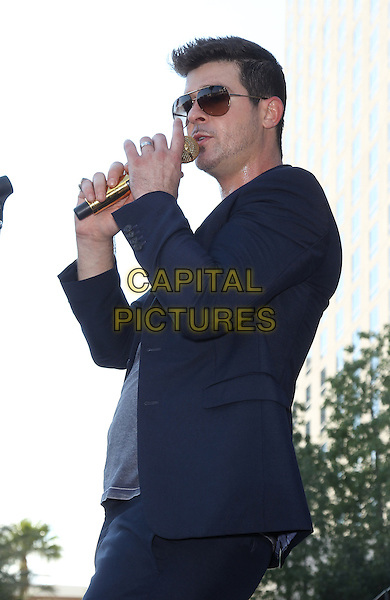 Robin Thicke<br /> performs at Ditch Friday's at Ditch Pool and Day Club at The Palms Casino Resort,  Las Vegas, Nevada, USA, 13th September 2013.<br /> music live gig concert on stage half length singing suit navy blue suit grey gray t-shirt sunglasses side <br /> CAP/ADM/MJT<br /> &copy; MJT/AdMedia/Capital Pictures
