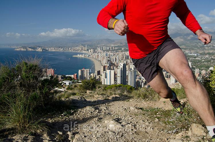 Running at Sierra Helada with Benidorm in background, Comunidad Valenciana,Costa Blanca,Alicante province,Spain,Europe