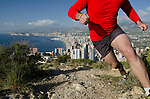 Running at Sierra Helada with Benidorm in background, Comunidad Valenciana,Costa Blanca,Alicante province,Spain,Europe