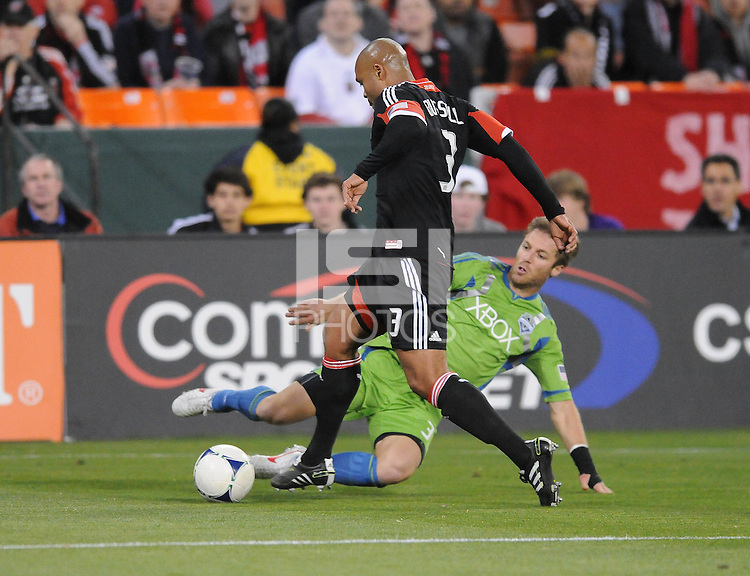 D.C. United defender Robbie Russell (3) goes against Seattle Sounder midfeidler Brad Evans (3)  D.C. United tied The Seattle Sounders 0-0 at RFK Stadium, Saturday April 7 , 2012.