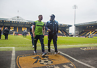 Wycombe Wanderers Assistant Manager Richard Dobson and Adebayo Akinfenwa of Wycombe Wanderers chat ahead of the Sky Bet League 2 match between Notts County and Wycombe Wanderers at Meadow Lane, Nottingham, England on 10 December 2016. Photo by Andy Rowland.