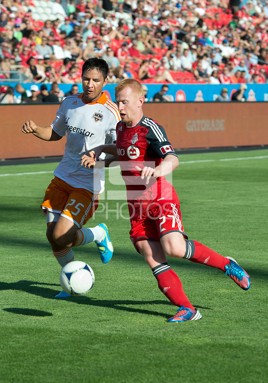 28 July 2012: Houston Dynamo forward Brian Ching #25 and Toronto FC defender Richard Eckersley #27 in action during an MLS game between Toronto FC and the Houston Dynamo at BMO Field in Toronto,Ontario Canada..The Houston Dynamo won 2-0...