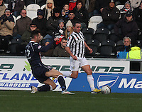 Mihael Kovacevic slides in to tackle Dougie Imrie in the St Mirren v Ross County Clydesdale Bank Scottish Premier League match played at St Mirren Park, Paisley on 19.1.13.