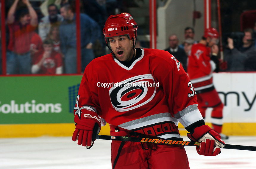 Carolina Hurricanes' Doug Weight seems to yawn during a game with the Boston Bruins at the RBC Center in Raleigh, NC Wednesday, March 1, 2006. The Hurricanes won 4-3...