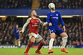 10th January 2018, Stamford Bridge, London, England; Carabao Cup football, semi final, 1st leg, Chelsea versus Arsenal; Jack Wilshere of Arsenal battles to win a header against Alvaro Morata of Chelsea