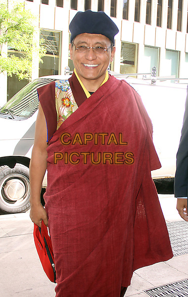 Holiness the Gyalwang Drukpa <br /> At SiriusXM Studios in New York City, New York, USA.<br /> September 25th, 2013 <br /> half length red sari black hat glasses<br /> CAP/MPC/RW<br /> &copy;RW/ MediaPunch/Capital Pictures