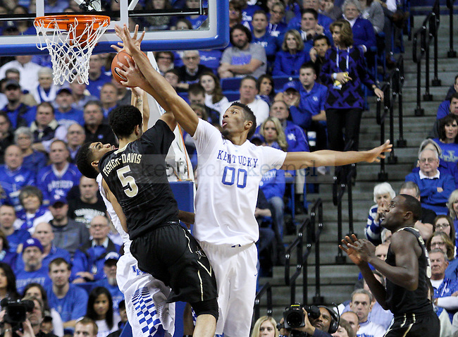 Kentucky forwards Karl-Anthony Towns (left) and Marcus Lee (right) block a shot during the second half of the University of Kentucky vs. Vanderbilt game at the Rupp Arena in Lexington, Ky., on Tuesday, January 20, 2015. Photo by Jonathan Krueger | Staff