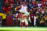 Landover, MD - November 4, 2018: Atlanta Falcons tight end Austin Hooper (81) jumps over new Washington Redskins safety Ha Ha Clinton-Dix (20) during game between the Atlanta Falcons and the Washington Redskins at FedEx Field in Landover, MD. The Falcons defeated the Redskins 38-13. (Photo by Phillip Peters/Media Images International)