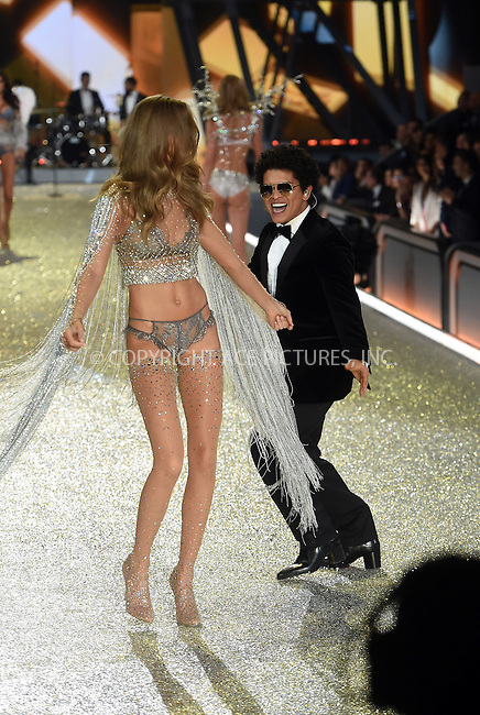 www.acepixs.com<br /> <br /> November 30 2016, New York City<br /> <br /> Bruno Mars performs on the runway during the Victoria's Secret Fashion Show on November 30, 2016 in Paris, France.<br /> <br /> By Line: Alain Benainous/ACE Pictures<br /> <br /> <br /> ACE Pictures Inc<br /> Tel: 6467670430<br /> Email: info@acepixs.com<br /> www.acepixs.com