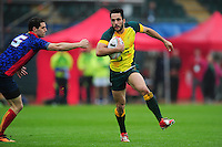 Brandon Quinn of Australia in possession. FISU World University Championship Rugby Sevens Men's Semi Final between Australia and Spain on July 9, 2016 at the Swansea University International Sports Village in Swansea, Wales. Photo by: Patrick Khachfe / Onside Images