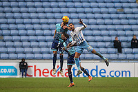 Will De Havilland of Wycombe Wanderers beats Marcus Tudgay of Coventry City & Marcus Bean of Wycombe Wanderers to the ball during the The Checkatrade Trophy - EFL Trophy Semi Final match between Coventry City and Wycombe Wanderers at the Ricoh Arena, Coventry, England on 7 February 2017. Photo by Andy Rowland.