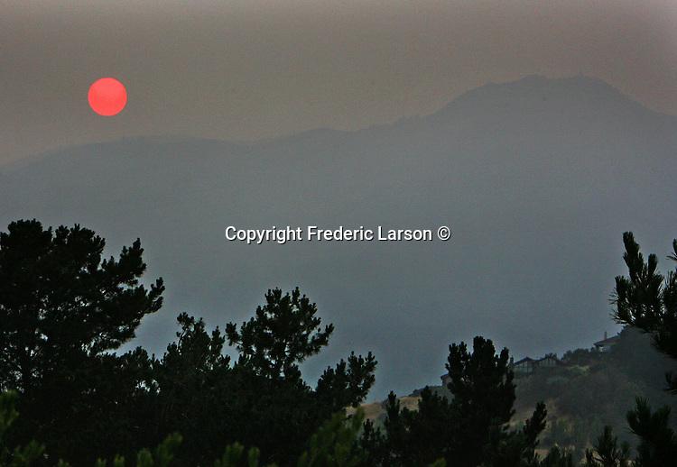 The sun slowly sets behind Mt. Tamalpais in Mill Valley, California.