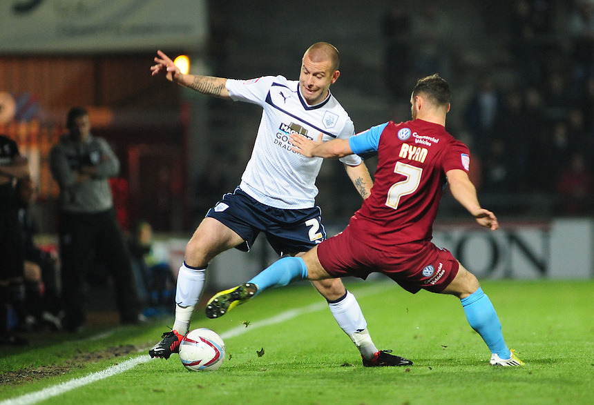 Preston North End's Keith Keane vies for possession with Scunthorpe United's Jimmy Ryan ..Football - npower Football League Division One - Scunthorpe United v Preston North End - Tuesday 23rd October 2012 - Glanford Park - Scunthorpe..