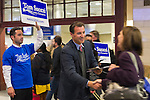 Manhattan, New York, U.S. 4th November 2013. TOM SUOZZI, Democratic candidate for Nassau County Executive, (center) meets potential voters during his campaign stop at Penn Station, near end of 36 straight hours of barnstorming across Nassau County, leading up to the November 5 general election. Former Nassau County Executive Suozzi and incumbent Republican Mangano are once again facing each other as challengers.