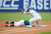 Michael Busch (15) of the North Carolina Tar Heels waits for a pick-off throw as Carl Chester (9) of the Miami Hurricanes dives back into first base during the second semifinal of the 2017 ACC Baseball Championship at Louisville Slugger Field on May 27, 2017 in Louisville, Kentucky. The Tar Heels defeated the Hurricanes 12-4. (Brian Westerholt/Four Seam Images)