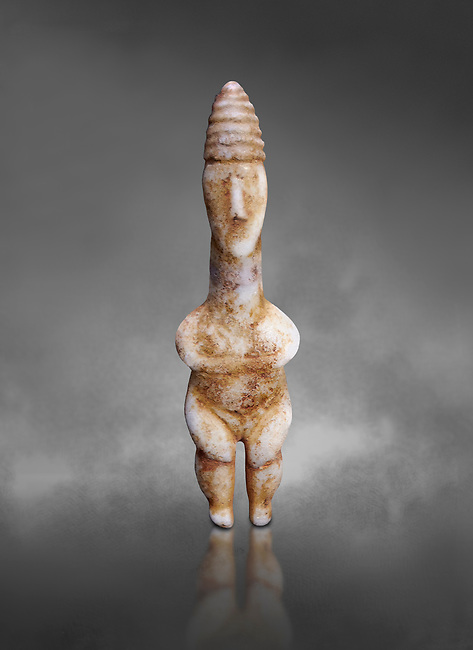 Marble ancient Greek Cycladic figurine wearing a conical pilos, early Plastiras type, Early Cycladic Period I, circal 2800 BC, Museum of Cycladic Art Athens, cat no 1111.  Against Grey Background.