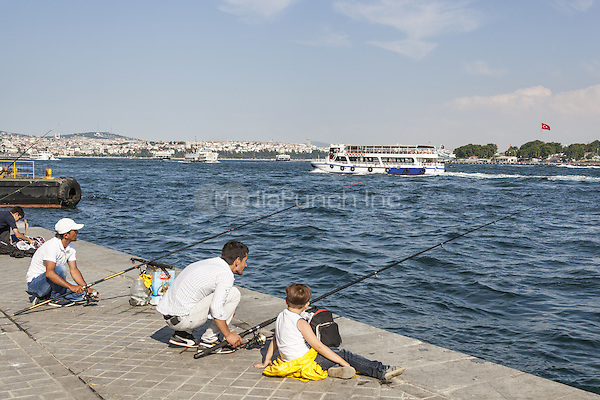 Men fishing on quayside, and passenger ferry passing, in the Bosphorus Strait, Istanbul, Turkey  May 2015.<br /> CAP/MEL<br /> &copy;MEL/Capital Pictures /MediaPunch ***NORTH AND SOUTH AMERICA ONLY***