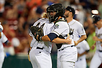 Kane County Cougars relief pitcher Breckin Williams (44) celebrates with catcher Tim Susnara (6) after recording the final out of a game against the West Michigan Whitecaps on July 19, 2018 at Northwestern Medicine Field in Geneva, Illinois.  Kane County defeated West Michigan 8-5.  (Mike Janes/Four Seam Images)