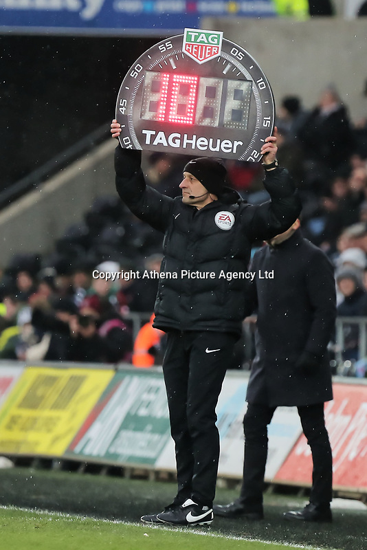 The fourth official shows 10 minute of extra time during the Premier League match between Swansea City and West Ham United at The Liberty Stadium, Swansea, Wales, UK. Saturday 03 March 2018