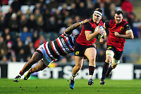 Rory Scannell of Munster Rugby is tackled by Manu Tuilagi of Leicester Tigers. European Rugby Champions Cup match, between Leicester Tigers and Munster Rugby on December 17, 2016 at Welford Road in Leicester, England. Photo by: Patrick Khachfe / JMP