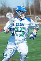 Sharp Jones,'16, races to the goal as the Seahawks battle Endicott in Men's Lacrosse at Gaudet Field in Middletown.