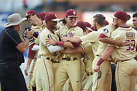 Drew Mendoza (22) of the Florida State Seminoles is mobbed by teammates following the final out in the 2017 ACC Baseball Championship Game against the North Carolina Tar Heels at Louisville Slugger Field on May 28, 2017 in Louisville, Kentucky. The Seminoles defeated the Tar Heels 7-3. (Brian Westerholt/Four Seam Images)