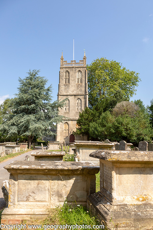Tower of church of Saint Mary, Berkeley, Gloucestershire, England, UK chest tombs in graveyard