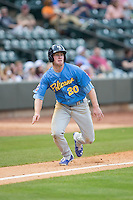Billy McKinney (20) of the Myrtle Beach Pelicans takes his lead off of third base against the Winston-Salem Dash at BB&T Ballpark on April 18, 2015 in Winston-Salem, North Carolina.  The Pelicans defeated the Dash 8-4 in game two of a double-header.  (Brian Westerholt/Four Seam Images)