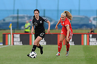 Olivia Chance of New Zealand Women's vies for possession with Charlie Estcourt of Wales Women's' during the Women's International Friendly match between Wales and New Zealand at the Cardiff International Sports Stadium in Cardiff, Wales, UK. Tuesday 04 June, 2019