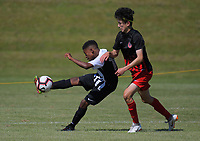 Action from the 2018 New Zealand Age Group Football Championships Under-14 Boys match between Mainland (black tops) and Northern at Memorial Park in Petone, Wellington, New Zealand on Wednesday, 12 December 2018. Photo: Dave Lintott / lintottphoto.co.nz