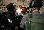 """Israeli police clash with Palestinians outside the Al Aqsa mosque compound in the Old City of Jerusalem on April 16, 2014. Dozens of Palestinians were wounded in clashes with Israeli police that erupted when Jerusalem's flashpoint Al-Aqsa mosque compound which was opened to Jewish visitors. Palestinians threw """"stones and firecrackers"""" at police when they opened the walled compound's gates and Israeli police responded with stun grenades and rubber-coated bullets, they closed the complex to the Jewish visitors after a small number had toured the site. Photo by Saeed Qaq"""