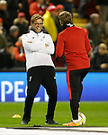 Manager of Liverpool, Jurgen Klopp jokes with Bastian Schweinsteiger of Manchester United during the UEFA Europa League match at Anfield. Photo credit should read: Philip Oldham/Sportimage