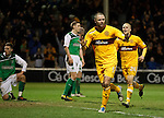 Michael Higdon celebrates his overhead kick goal as Hibs are dejected