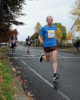 26/10/2015; 2015 SSE Airtricity Dublin Marathon, St Laurence's Road, Dublin. <br /> Raymond Carolan.<br /> Picture credit: Tommy Grealy/actionshots.ie.