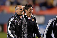 Houston Dynamo head coach Dominic Kinnear is all smiles along with forward Brian Ching who scored the winning goal on the night. The Houston Dynamo beat the Colorado Rapids 1-0 on a goal by Brian Ching, April 29, 2006, at Invesco Field at Mile High Stadium in Denver, Colorado.