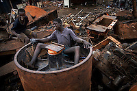 Children take a break from burning cables at Agbogbloshie dump, which has become a dumping ground for computers and electronic waste from all over the developed world. Hundreds of tons of e-waste end up here every month. It is broken apart, and those components that can be sold on, are salvaged.