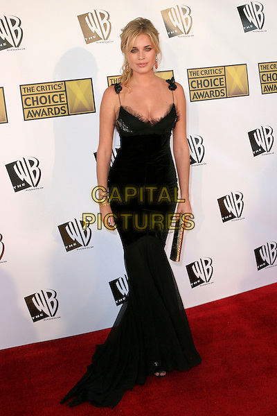 REBECCA ROMIJN.11th Annual Critics' Choice Awards - Arrivals held at Santa Monica Civic Auditorium, Santa Monica, California..January 9th, 2006.Photo: Zach Lipp/AdMedia/Capital Pictures.Ref: ZL/ADM.full length black dress gold clutch purse.www.capitalpictures.com.sales@capitalpictures.com.© Capital Pictures.