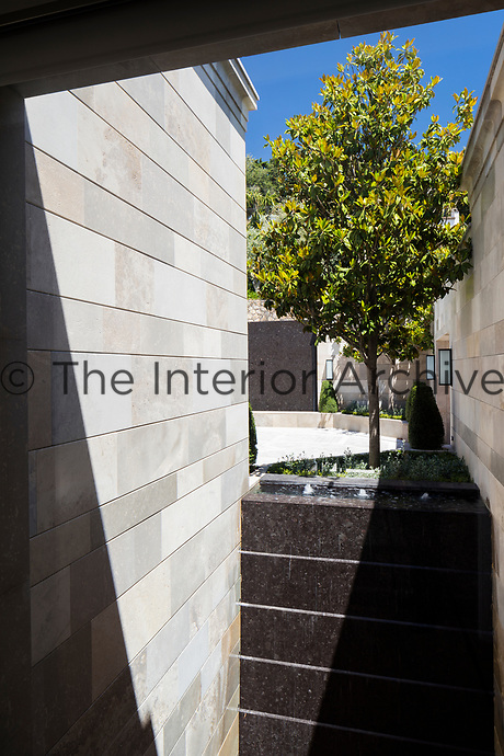 The exterior grounds of the villa are divided into a series of courtyard spaces.