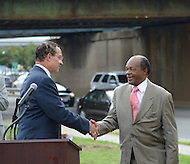 August 25, 2011 (Washington, DC)  DC Mayor Vincent Gray (D-DC) (left) and Marion Barry Jr. (D-Ward 8) shake hands at a press conference announcing the designation of the Southeast/Southwest Freeway, the 11th Street Bridge and sections of Maine and Independence Avenues SW as Martin Luther King, Jr. Drive.  (Photo by Don Baxter/Media Images International)